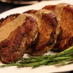 Creamy Herbed Pork Chops | A beefy basil-cream sauce sends these brown beauties out of sight.