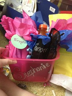 "These were my Party/ Hangover kits I made for my friends bachlorette party.  Inside  ""Tonight""- chocolates, goblet, small bottle of wine and a little pocket mirror ""tomorrow"" -gatorade, mints, Tylenol packets, sunglasses (I meant to put tums as well) Thanks to the dollar store less than $10 a piece and were adorable"
