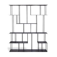 Through the clean, suspended lines of steel, the Helix pieces define a space while maintaining a sense of transparency. The open, unspun-helix structure of each shelving unit creates a visual and architectural experience. Exclusively at ABC.