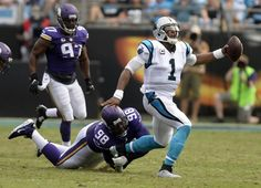Carolina Panthers quarterback Cam Newton (1) has his ankle twisted as he is tackled by Minnesota Vikings defensive tackle Linval Joseph (98) in the first half at Bank of America Stadium on Sunday, September 25, 2016. The slight injury forced Newtown out of the game for one play. The Vikings won, 22-10.