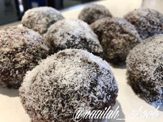 """Chocolate Snowballs  By Yasmin Tar 💗 Picture credit: @naailah__akoob 125g butter  3/4 cup sugar  1 tspn vanilla essence  3 tspn bp  3 eggs  1 1/2 cups flour  1/2 cup milk  Put in kenwood n beat for 5 minutes,put in cupcake pans n bake on 180""""  Syrup  1 cup icing sugar  1/2 cup water  1 slice butter  Red Colouring boil nicely dip cakes into syrup n into coconut than eat n enjoy 😜💗 Yasmin Tar  For the chocolate syrup I used my moms recipe (Nafisa Akoob), I boiled: 1 cup sugar 1.5 cup water… Chocolate Snowballs, Chocolate Syrup, Cake Dip, Cupcake Pans, Vanilla Essence, Picture Credit, Recipe For Mom, 1 Cup, Icing"""