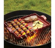 Emile Henry BBQ Ceramic Kabob Grilling Stone with Skewers | CHEFScatalog.com///Professional-glazed ceramic provides smooth release and effortless cleanup. Oval-shape handle ensures a comfortable, ergonomic grip. High-fired burgundy clay is resistant to thermal shock, mechanical shock, chipping and scratching. Stain- and odor-resistant. penetrate food. Eight metal skewers with hanging loop. Broiler-safe, microwave- (stone) and freezer-safe. Dishwasher-safe. Grilling stone from Marcigny…