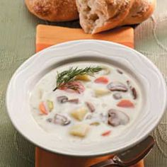 Mushroom Potato Soup Recipe -A buttery mushroom flavor blends with potatoes, leeks and carrots to make this soup hearty and warming. A big steaming bowl hits the spot on a cold fall day. Waxy red potatoes and all-purpose Yukon Golds hold together well in boiling water.
