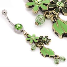 "14g (7/16"") Peridot Flowers n Leaves Belly Button Jewelry: Whether you were born in August or you just love the color green, you're sure to love our new 14g (7/16"") Peridot Flowers n Leaves Navel Ring! The shaft is 316L stainless steel, and the navel ring has a 5mm steel ball. The entire dangle is about 1.25"" long. Price per 1. Price: $5.99 for 1 or $5.49 each when you buy 2+."