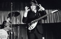 the beatles funny   John Lennon pulls a funny face while performing on a US tour