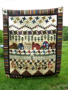 a very scrappy thimbleberries row quilt.