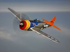 A Republic P-47D Thunderbolt in Flight Photographic Print by Stocktrek Images from AllPosters.com