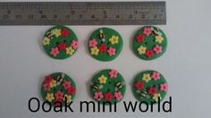 Check out this item in my Etsy shop https://www.etsy.com/listing/222912536/polymer-clay-floral-buttons-set-of-6