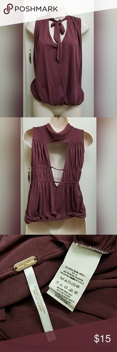 Free People tie top In good condition very cute top ties around neck gathers on the bottom giving a Simi loose fit with open back. Color is a purple red color.  CHECK OUT MY OTHER LISTINGS ON MORE AMAZING DEALS Free People Tops Blouses
