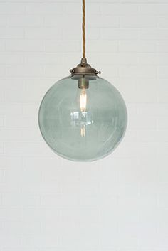 Celebrating the beautifully reflective qualities of glass, we've taken one of our most popular pendant lights – the Holborn – and paired it with a greeney blue clear glass shade so you can enjoy its delicate hues in your kitchen, bedroom or dining room. Glass Pendant Light, Ceiling Pendant, Glass Pendants, Industrial Pendant Lights, Pendant Lighting, Ceiling Rose, Pastel Interior, Interior Ideas, Glass Collection
