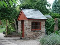 Potting shed bench in garden setting by howard design for Brick garden shed designs