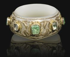 AN EXCEPTIONAL IMPERIAL OTTOMAN ARCHER'S RING (ZIHGIR), INDIA AND TURKEY, 16TH CENTURY the pale grey jade of typical form, with emeralds and diamonds set into gold mounts on the jade