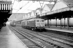 26021 and 26030 glide almost silently through a doomed and gloomy Sheffield Victoria 29 Dec 1969 During the last week of scheduled operations at Sheffield Victoria which was closed to passenger traffic with effect from 5 Jan Electric Locomotive, Diesel Locomotive, Sheffield England, Train Pictures, Electric Train, British Rail, Pipe Dream, Old Photos, Trains