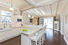 Modern Cottage kitchen white and dark floorboards