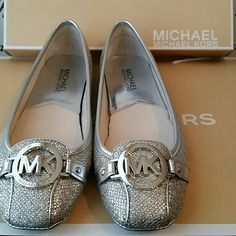 HP x 2  NWT Michael Kors Silver Glitter flats NWT Michael Kors Silver Glitter flats (Fulton Moc). This shoes are gorgeous & sparkle with silver glitter that just makes you smile. They are true to size and they will come with the original box. No trade No paypal, Happy Poshing Michael Kors Shoes Flats & Loafers