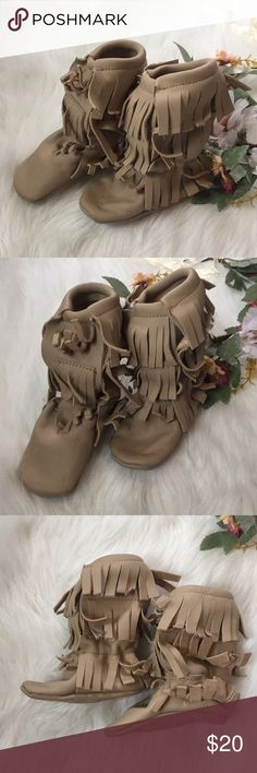 Brand new moccasin boots! Incredibly cute on. So stinking cute on toddlers. These are genuine leather handmade by a local artist. I bought these and my daughter wore them once for photos. They're made with elastic so they'll stretch on legs. Shoes Moccasins