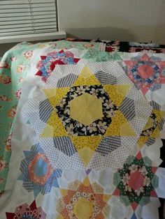 Camille's large Rose Star block, sewn on sewing machine, all kite shapes.  The large block is sitting on top of smaller block partial quilt top.
