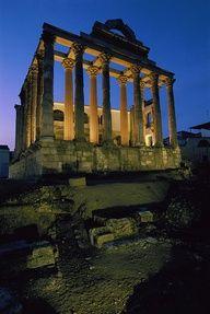 View of the Roman Temple of Diana, illuminated at dusk – Merida, Spain