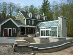LOVE the attached greenhouse, especially with the chimney at the end, i want one directly off my kitchen <3