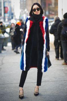 Eva Chen goes patriotic in a Rebecca Minkoff fur vest, a Proenza Schouler sweater, Levi's jeans and Marc Jacobs shoes // Eva Chen's Amazing Technicolor NYFW Coats