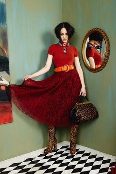 Red & leopard are so happy together. Red polo with rainbow collared detail with a mid-length lace skirt. A leopard bag and boots are this seasons must have accessories. #aofall16