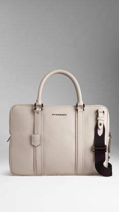 London Leather Crossbody Briefcase | Burberry $1,695.00 Item 38735031 TRENCH         London leather crossbody briefcase with protective padding         Zip closure features an integrated padlock         Rolled leather handles, detachable webbed canvas crossbody strap         Polished metal hardware         27 x 37 x 7cm         10.6 x 14.6 x 2.8in         100% calf leather         Check lining         Imported
