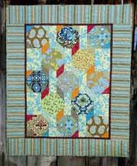 Gypsy Caravan Quilt Pattern by Pixie Girl Quilts at KayeWood.com. A snowball block with a different fabric in each corner gives this quilt that carefree wandering feeling of a Gypsy Caravan.  http://www.kayewood.com/Gypsy-Caravan-Quilt-Pattern-by-Pixie-Girl-Quilts-PGQ-GYCA.htm $6.00