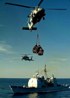 USS Bunker Hill (CG 52) (MH-60S Sea Hawk helicopters deliver supplies.