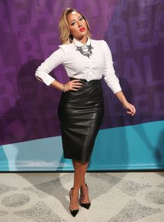 Adrienne is working it a Valentino blouse, Zara skirt and Christian Louboutin heels.
