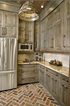 I love this but its too much gray. Maybe do a different color cabinet on top? Or exposed industrial rustic shelving??