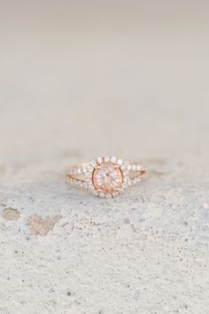 Loving this unique colored rose gold halo engagement ring.