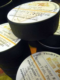 I always love a little creativity and individuality: hockey puck wedding invitations