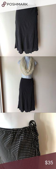 Black and white polka dot skirt, cinnamon girl Vintage cinnamon girl skirt from year 2001 - excellent condition. Worn only a couple times. Tie waist. Adjustable, fits like an XS / S :) midi length cinnamon girl Skirts Midi