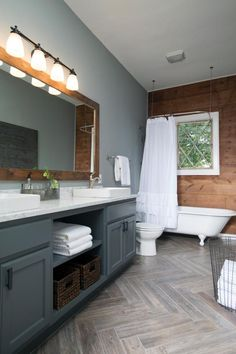 HGTV Fixer Upper Interior Paint Color Ideas from Joanna Gaines - Grays, Whites, Blues - Rustic Bathroom With Wood Grain and Gray Tones