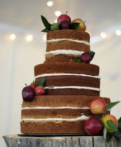 Triple tier chocolate wedding cake with fresh apples, natural style