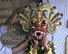 Image: A Sri Lankan traditional dancer wears a mask in Colombo, Sri Lanka, on Feb. 15