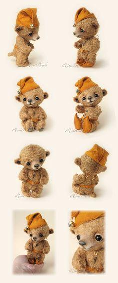 An amazing felt (albeit not needle felted) bear by Rina Bushe  http://www.rinabears.com