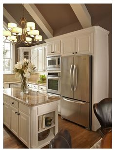 white cabinets, wood floors, light countertops