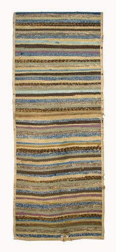 Shaker Rug Estimate: $1,000 – $1,500 Cotton, made with strips of used material in multiple colors, green, brown, purple, mottled blue, gra...