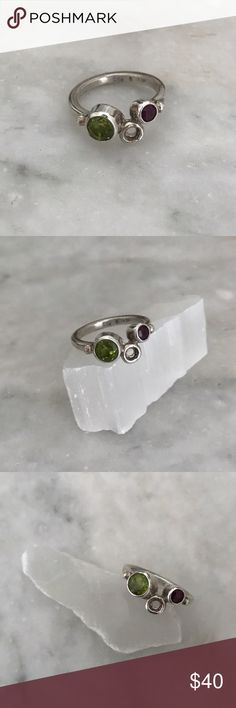 Silver, peridot and garnet ring Handmade, sterling silver (925) with faceted peridot and garnet. Once upon a time, I made and designed jewelry in my own workshop. One day I fell in love and decided to move to a far away land with the man I love, and to pursue a different career. This is one of the last pieces I made and it has been sitting in a box with the other survivors of that time... it's new, but obviously it doesn't have a tag. Tagged Anthropologie for exposure. Anthropologie Jewelry…