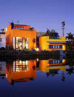 """The front canal acts like a mirror to the property, at dusk reflecting the house that glows like a Chinese lantern. Galán's take: \""""a modernist Latino painting.\""""    More Homes of the Times: California design profiles in pictures"""