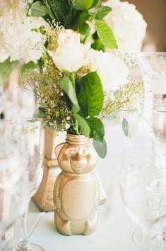 gold honey bear centerpiece - photo by Onelove Photography http://ruffledblog.com/romantic-wedding-handcrafted-by-the-groom #weddingideas #centerpieces