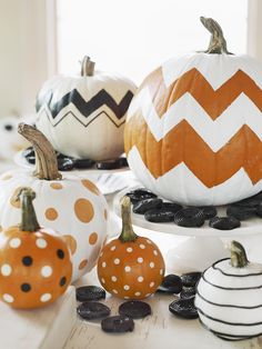 Who needs to carve a pumpkin when you can easily make patterned and chevron pumpkins with masking tape!