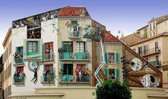 Cinéma-Cannes, Place Cornut-Gentille de A Fresco  La contrainte principale imposée par ce mur, pour une bonne intégration architecturale, réside dans la prise en compte des quatre vraies fenêtres dans de fausses, peintes en trompe-l'œil. Cette donnée détermine le reste de la composition de la fresque… Les acteurs figurant sur la fresque forment des duos célèbres du 7ème Art.