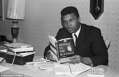 Reading in his downtime: At his home in Chicago, Ali is pictured reading 'Message to the Black Man' by Elihad Muhammad, the leader of the Na...
