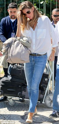 Simple chic: Gisele dressed casually in jeans and a white shirt and showed exactly why she...