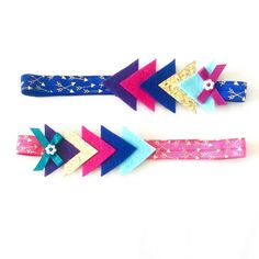 This trendy Aztec headband will look adorable in your little girls hair!  This headband is made from soft wool felt and glittery goodness attached to an adorable arrow elastic. Gracie Lou Boutique headbands are made with soft elastics to fit gently on your little ones head. Each headband is handmade with love and grace and will ship within 2 weeks. Colors may vary slightly than what appears on screen.