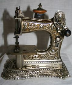 Antique F.W. Muller No. 6 Ladies' of this nickel-over-cast iron Sewing Machine