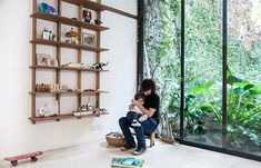 I like the design of these simple shelves which assemble without tools, and are hung from a rail mounted to the wall.