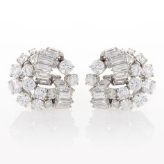 Mauboussin Platinum and Diamond Swirl Ear Clips.  Available exclusively at Macklowe Gallery.